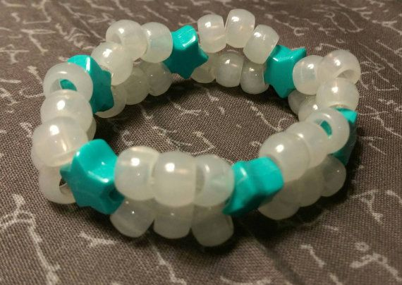 Check out this item in my Etsy shop https://www.etsy.com/listing/246511276/kandi-double-glow-in-the-dark-turquoise