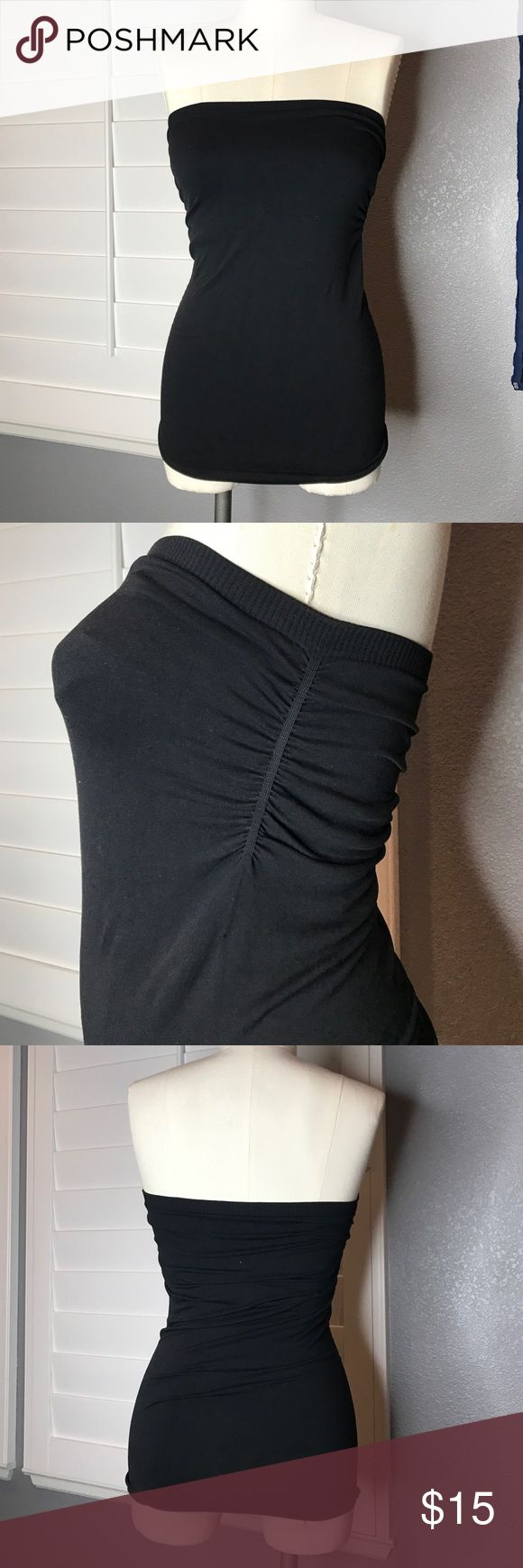 Tube Top • bebe • NWOT • Small From bebe, this black tube top is brand new, washed but never worn. Size Small, it features rouched sides and a built in shelf bra. This top is long, you can see it covered my mannequins butt so it will keep yours covered too! bebe Tops