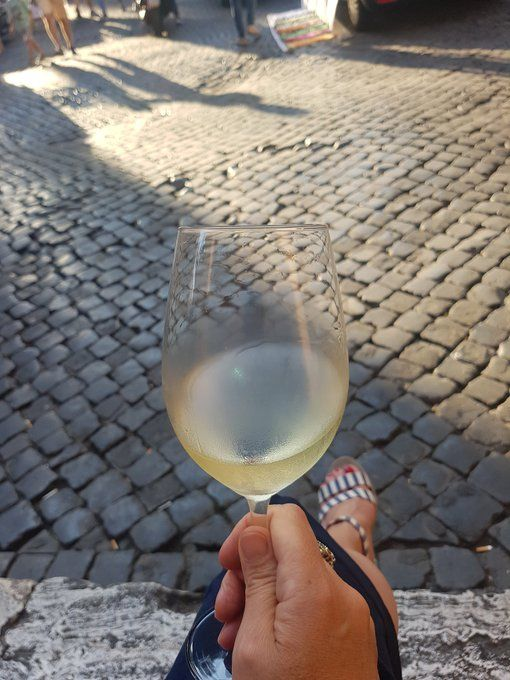 #FridayFeeling glass of white #wine, #rome , the breeze and a great tour ahead.