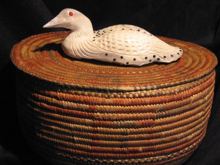 Inuit basket with carved moose bone loon handle
