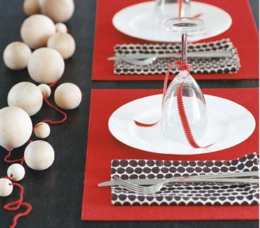 Look to the craft store for inexpensive decorating materials, like red felt rectangles used as place mats, and matching lengths of ribbon.