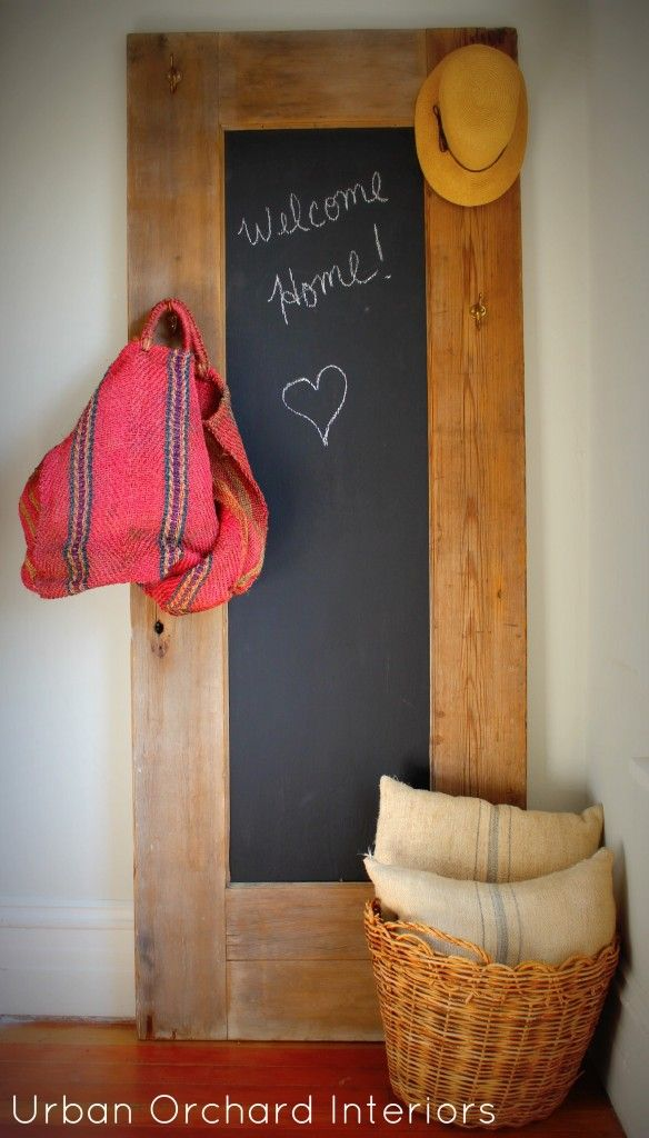 Antique door turned chalkboard. I think I just figured out what to put on the walls of the mudroom when I replace some of our interior doors!