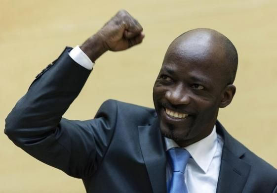 Charles Ble Goude of Ivory Coast clenches his fist as he enters the courtroom of the International Criminal Court for his initial appearance in The Hague March 27, 2014. Ble Goude faces charges of crimes against humanity linked to a 2011 post-election civil war. REUTERS/Michael Kooren