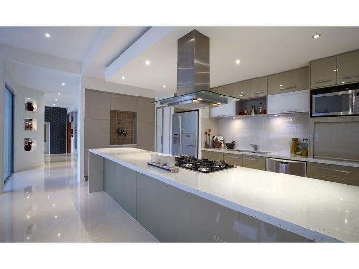 Kitchen: Ceramic Wood Cabinets Metal Pendant Lamp Chicken Statue Black Table Glass Window Refrigerator Stove Kettle Kitchen Island Plate Fruits Sink Knife Flower Vases Washbasin Floor Vegetable Oven White Chair Brown Wallpaper Chrome: SUPERIOR CUISINE EXPERIENCE OF CONVINCING KITCHEN DESIGNS