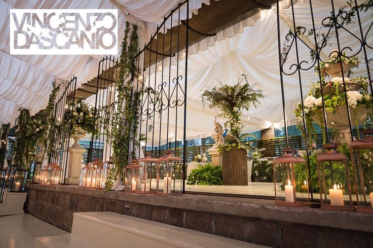Bucolic set up for dinner area, iron gates for a secret garden, castello di vincigliata