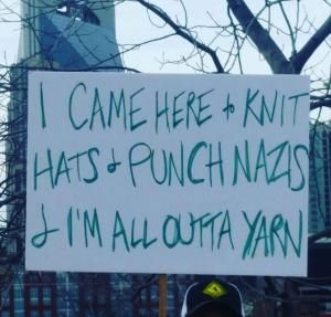 A must-see collection of clever and biting protest signs from the Women's March on Washington and sister marches around the world.: Knitting Hats and Punching Nazis