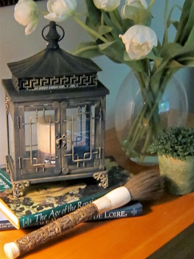 Asian sofa table vignette with lantern, white tulips and calligraphy brush