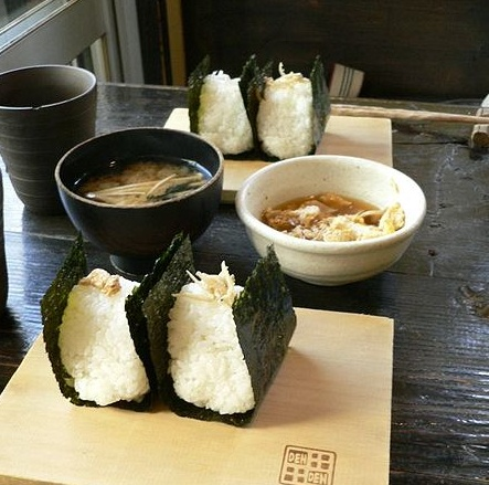 [ONIGIRI]  The rice bowl of a traditional Japanese takeout food.  There are various contents ingredients.   It is a basic form which is wrapped in the dried seaweed.