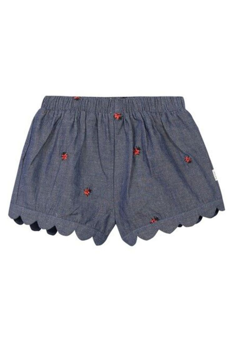 Made from 100% cotton-chambray, these dark indigo Paul Smith Junior baby girls' 'Noisette' shorts feature an embroidered 'Ladybird' motif throughout. Complete with pleat detailing, these are finished with an elasticated waistband and a Paul Smith Baby tab. Noisette Ladybug Shorts by Paul Smith. Girls - Bottoms - Shorts New York City