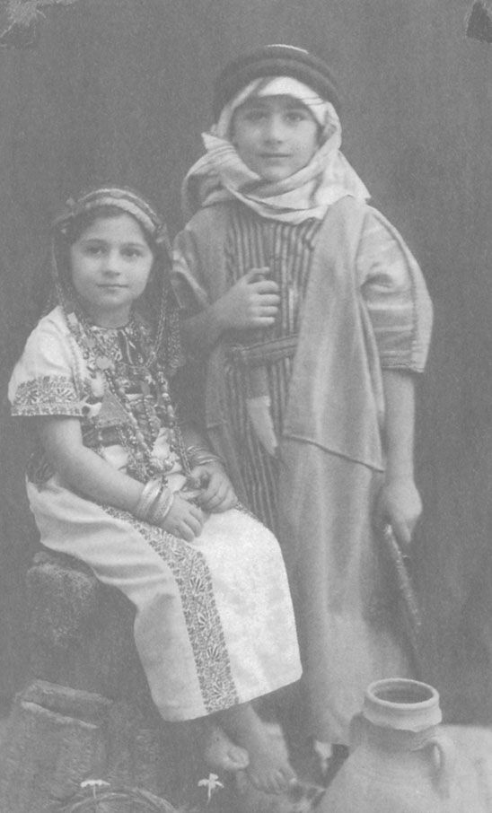 Edward Said and his sister Rosemarie in traditional Palestinian dress, Palestine, 1940.