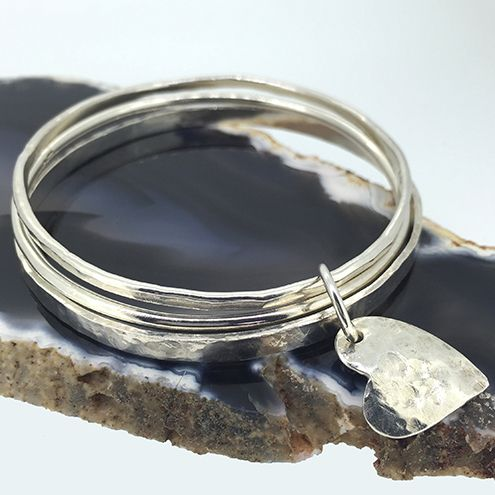 Three Sterling Silver Bangles with Heart Charm