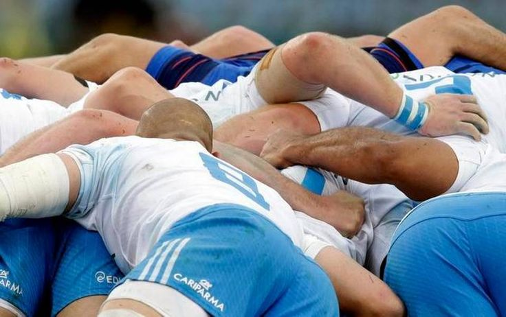 Players battle in a scrum during a Six Nations rugby union match between Italy and France, at Rome's Olympic Stadium, Sunday, March 15, 2015. (AP Photo/Andrew Medichini)