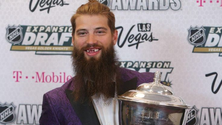 Ice Hockey player collecting the Norris Trophy for being best defenseman