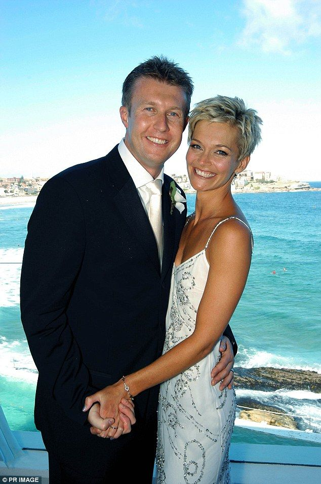 Happy: Pictured at their wedding day at Icebergs in Bondi in 20014