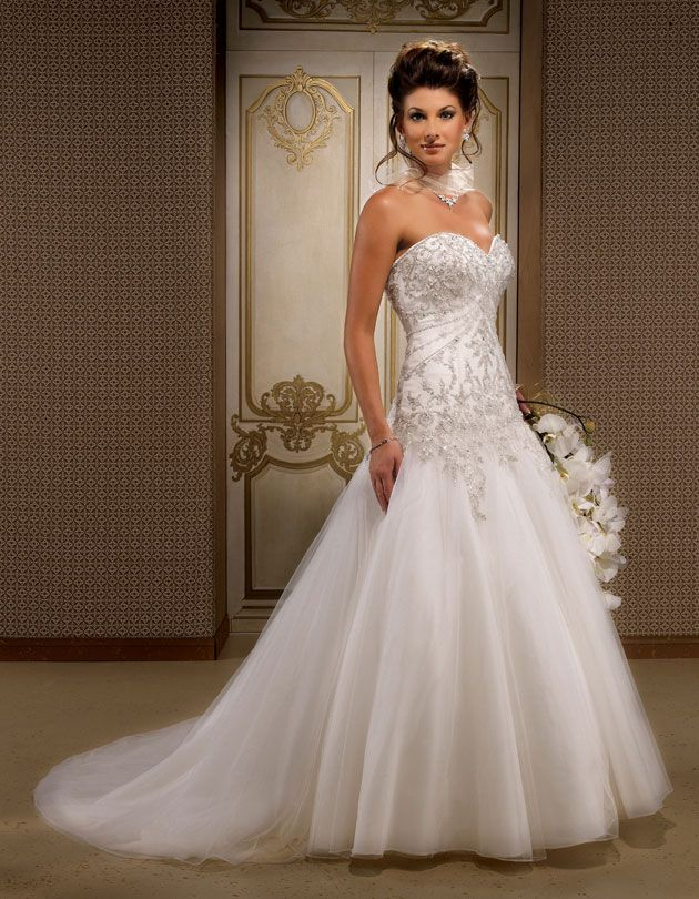 Gorgeous sleeveless ball gown floor-length wedding dress.