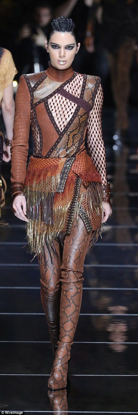 Back to nature: Braless Kendall Jenner, 21, wore a plunging cut-out patchwork snakeskin dr...