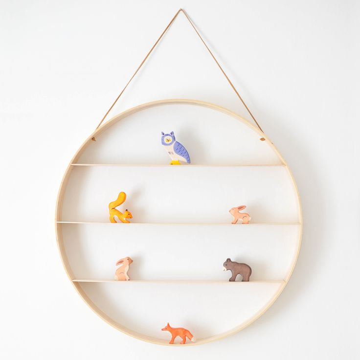 This circle shelf is the perfect place to display your favorite tiny objects.