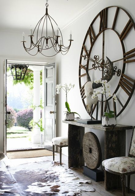how to decorate with large clocks - How To Decorate A Large Wall