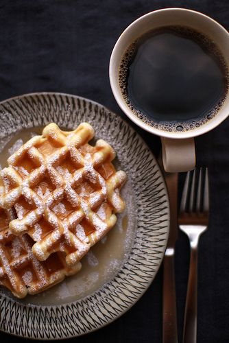 coffee & belgium-style waffles dusted with powdered sugar