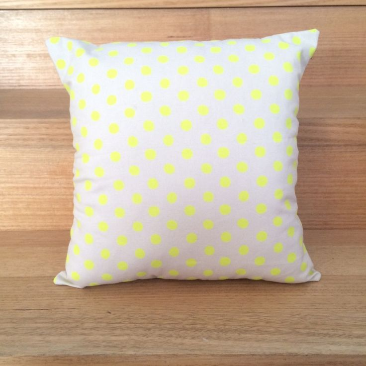 This cushion cover is hand sewn from cotton fabric. It is sewn as a slip style pillow with 2 buttons to keep it neatly closed. With a neutral background colour and bright yellow spots it is the perfect cushion to add some colour to any bedroom or lounge.Listing price is for cushion cover only. This cushion cover fits an insert of 35cm x 35cm.