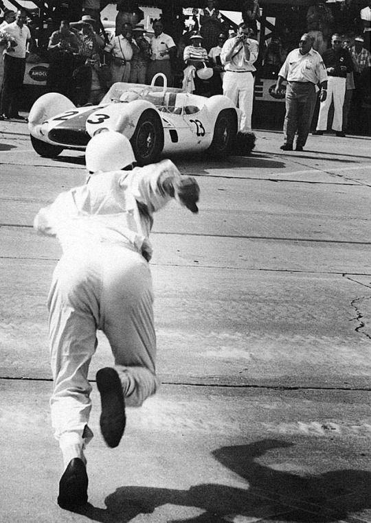 "Stirling Moss runs to his Maserati ""Birdcage""."
