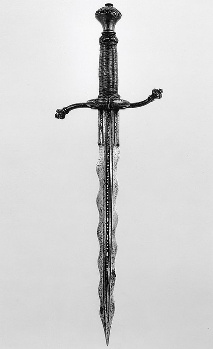 Parrying Dagger (Pugnale Bolognese) Dated: 1550–75 Culture: Italian Medium: partly gilt steel, brass, and wood Measurements: weight 15 oz. (425 g)