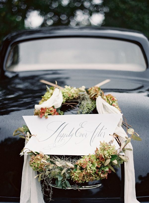 An elegant wreath for the getaway car #happilyeverafter