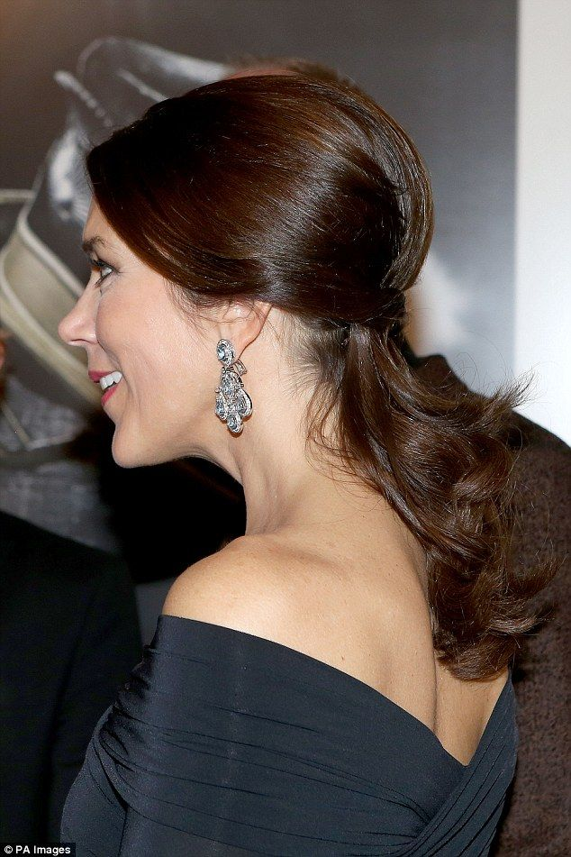 Glamorous: True to her effortlessly elegant style, she wore her hair pinned back to show o...
