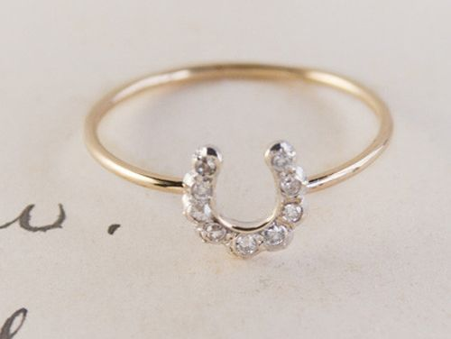 This Horseshoe Ring is a modified version of a gem-studded charm from a gentleman's stickpin, something he used to hold his cravat in place.