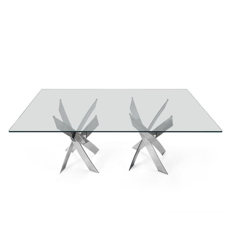 Twisted Dining Table - Dining Room Decor - Laskasas | Decorate your Life | Living up to the name, Twisted dining table is a futuristic styled table based on metal frame and clear glass top. Ideal for those who like bold and avant-garde bets and simultaneously the neutrality of glass, this unique piece is perfect for a modern dining room decoration. | www.laskasas.com and discover more glass top interior design ideas and inspirations for your interior design