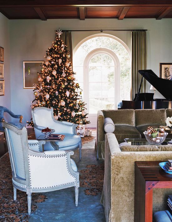 Simple holiday decor shimmers against this room's white walls. - Traditional Home ®/ Photo: Joe Schmelzer / Design: Catherine Bailly Dunne