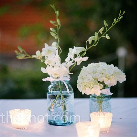 Centerpieces: Blue Ball jars filled with white hydrangeas and orchids provided the perfect simple centerpieces.