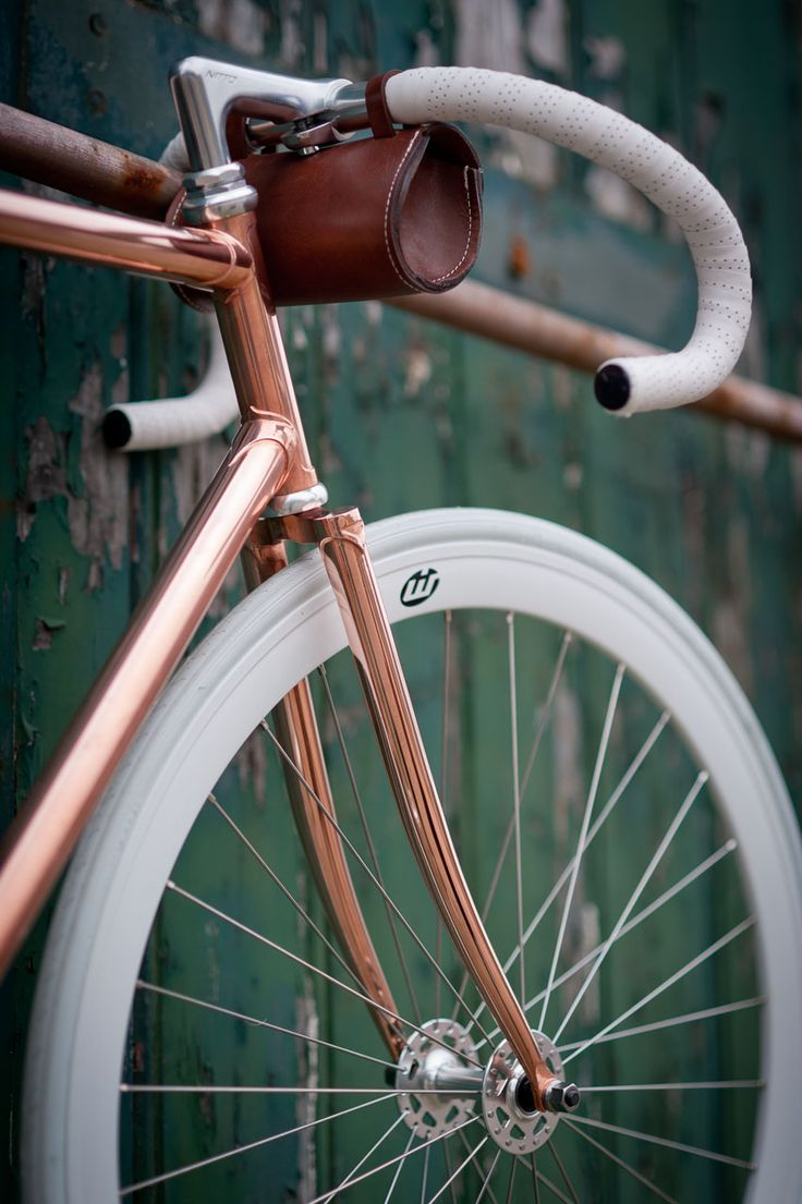 Copper bicycle with cool white handlebars. Really cool idea