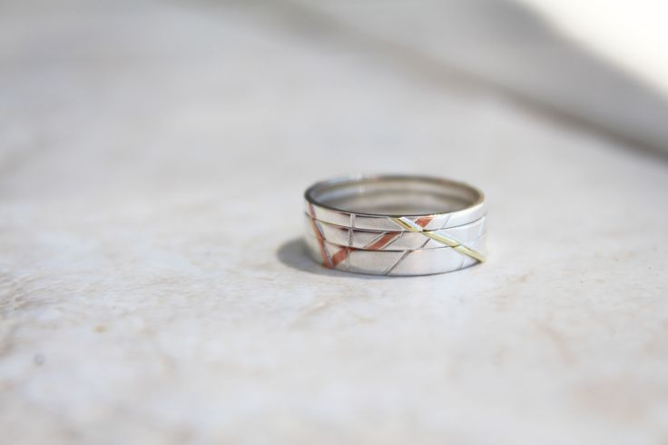 Multi-leveled wire inlay rings (2012)  Set of three, stackable 'thin rings'  (Sterling Silver, Brass, Copper)
