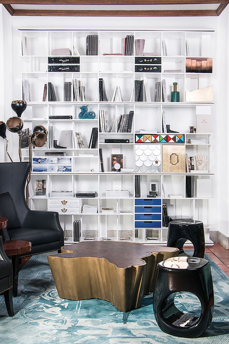 We dare to say that the star of the picture above is the Coleccionista Bookcase by Boca do Lobo but it would be unfair to the stunning silver Aquarius Center Table. The perfect interior design inspiration for a living room.