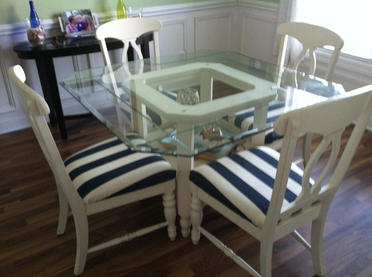 DIY nautical dining room- white furniture, striped upholstery, nautical accents on sideboard