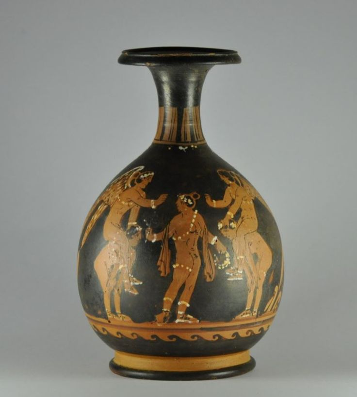 Paestan bottle with ephedrismos scene, 340 B.C. Paestan bottle red figured painted bottle from painter of Naples 1778, unpublished, attribuited by Prof. Ian MacPhee, 19.3 cm high. Ephedrismos was game where a target  on the ground is to be hit with a rock or a ball, the loser had to carry the winner, who covered the loser's eyes, on his back until he touched the target with his foot. Private collection