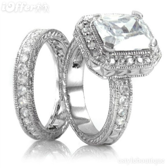 engagement + wedding rings.. love! :)