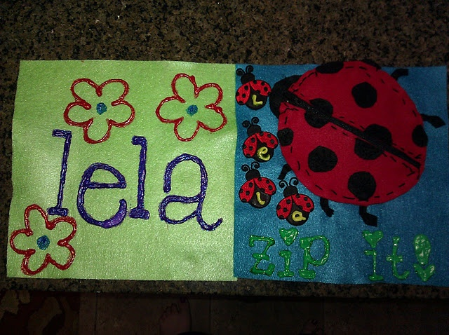 The first two pages of Lela's quiet book. :-) The mama ladybug unzips so that her babies can fit inside her back.  http://pinterest.com/pin/409861062/