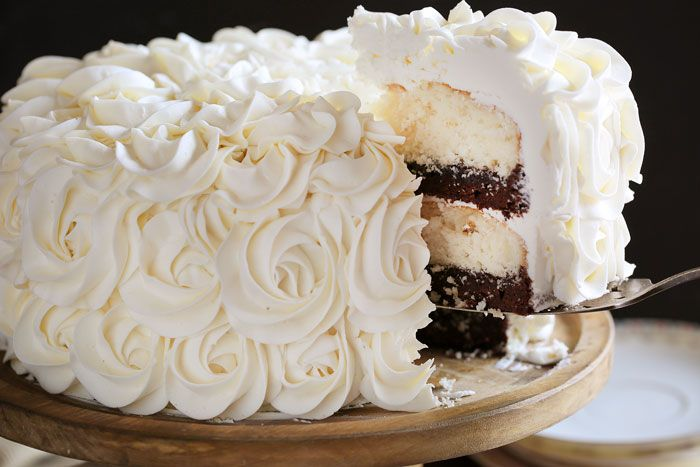 Stunning rosettes cover this flavorful cake... white cake layers complemented with rich fudgey brownie deliciousness!
