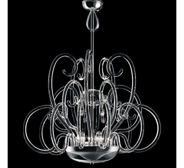 Luxor è una rivisitazione moderna del lampadario veneziano. Come nel lampadario classico i vetri e le figure partono da un centro e si snodano nello spazio in volute sinuose. In Luxor però la luce è indiretta. Le sorgenti di luce sono nascoste nella grande coppa centrale e producono riflessi e trasparenze nei bracci di vetro pieno che sono lisci, incolori e fino a 3 forme diverse, per formare – combinati – sette modelli differenti in un gioco di riflessi e sinuosità. Cromo lucido per la…