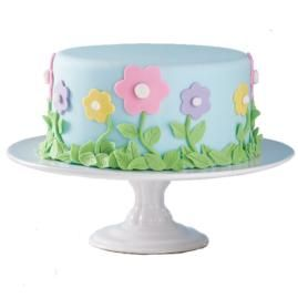 Garden of Delight. Beautiful flowers are blossoming up the sides of this botanic masterpiece. Fondant leaves and blooms make the cake come to life in a rainbow of colors.