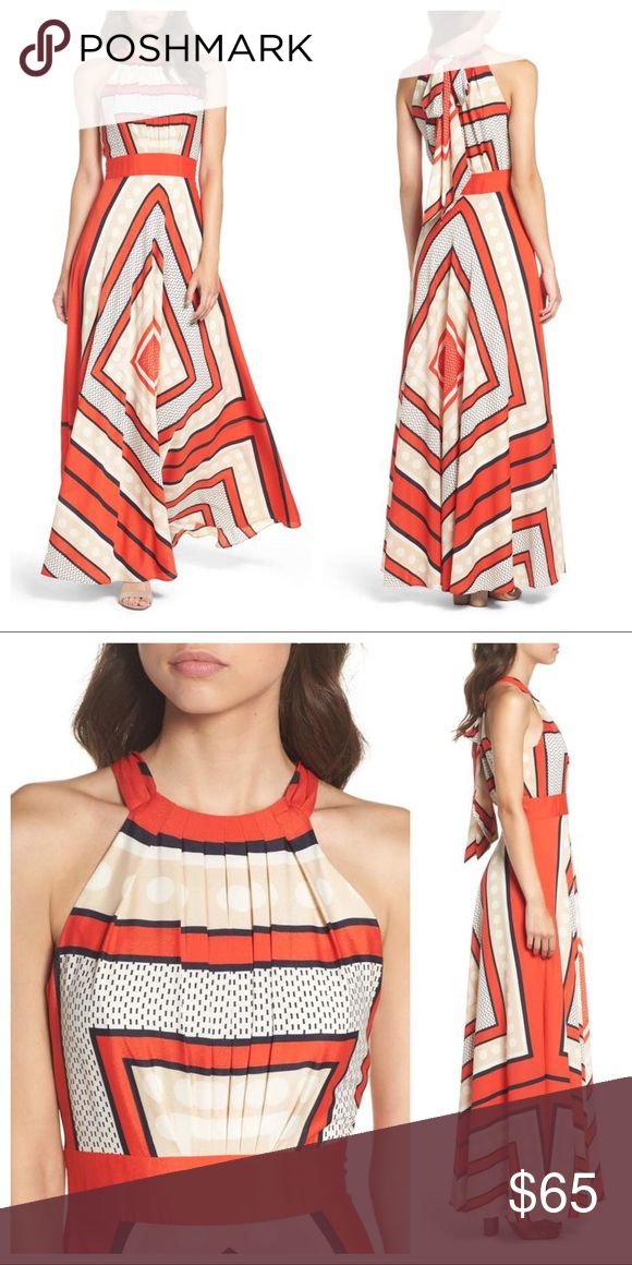 """Eliza J Scarf Print Crêpe de Chine Fit Flare Maxi Currently full price on Nordstrom website! Perfect pre worn condition. A graphic mix of dots, diamonds and dashes brightens a flowy, stretchy maxi dress with a high, pleated neckline and cutaway shoulders. 61"""" regular center front length (size 8); 54"""" petite center front length (size 8P). Hidden side-zip closure; back keyhole with tie closure. Cutaway shoulders. Fully lined. 100% polyester. Dry clean. Eliza J Dresses Maxi"""