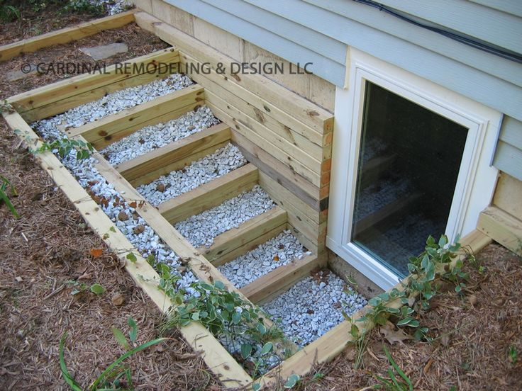 egress window idea.  I'm so drooling right now.  Would love this in the back corner of the house.