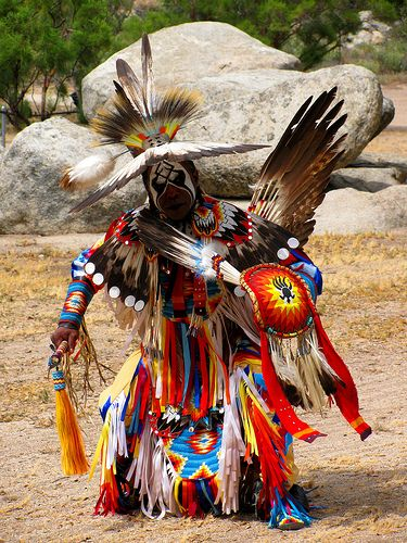 Native American Pow Wow. Once considered a deviant race but they worked towards keeping true to their roots regardless of American societies judgement.