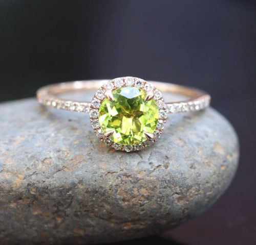 This Beautiful 14k Gold Single Halo Ring Features a flawless Natural Peridot Round measuring 7mm and surrounded with Natural Diamonds. The