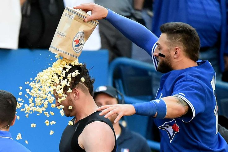 Don't forget the popcorn -  Toronto Blue Jays center fielder Kevin Pillar (right) pours popcorn over the head of teammate Josh Donaldson after he hit a walk-off home run in the ninth inning to give the Jays a 5-4 win over Tampa Bay Rays on Sept. 27 in Toronto. - © Dan Hamilton/USA TODAY Sports