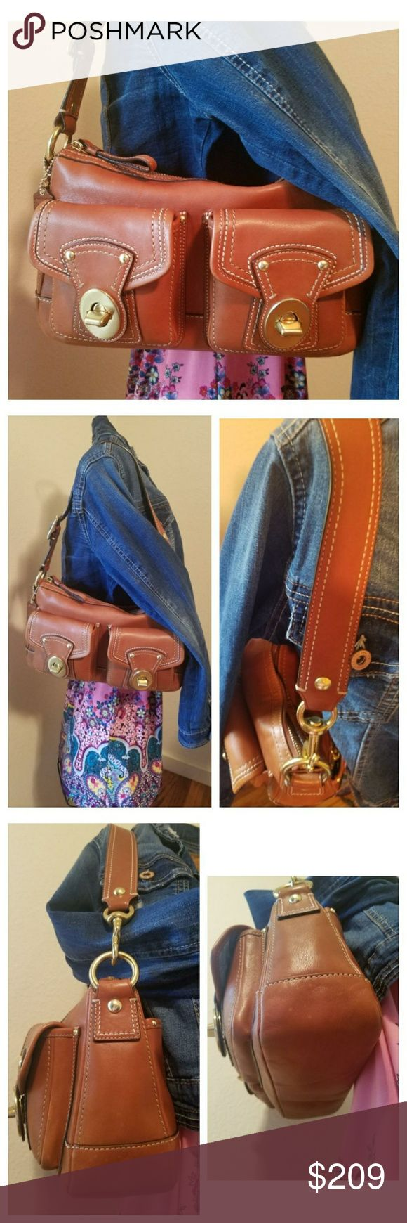 Coach Legacy Whiskey Hobo A beautiful Coach bag; style F12868 in great condition. Exterior has 2 front pockets w/turn locks & a full length back pocket that is zippered. Interior: 2 inside slip pockets on the front wall & a back wall zipper pocket w/blue signature print sateen material. There are a few small discolored spots in the leather; on the front by the zipper & on the back top. Please see pics. Those areas should blend in eventually once the leather gets patina. Brass colored…