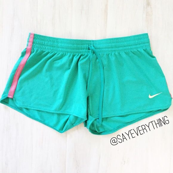 """Nike Green Jersey Shorts Fun and bright teal green mesh shorts. They're like a basketball jersey material - polyester/spandex. Size L with stretch. Waist is 16"""" across and 3"""" inseam. Pink stripe on either side. Perfect for lounging or wearing for a workout! Excellent condition. Thank you for looking! Nike Shorts"""
