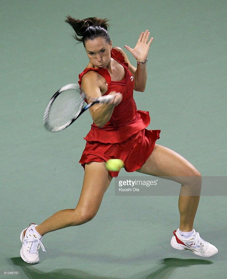 Jelena Jankovic of Serbia returns a shot in her match against Elena Vesnina of Russia on day four of the Toray Pan Pacific Open Tennis tournament at Ariake Colosseum on September 30, 2009 in Tokyo, Japan.